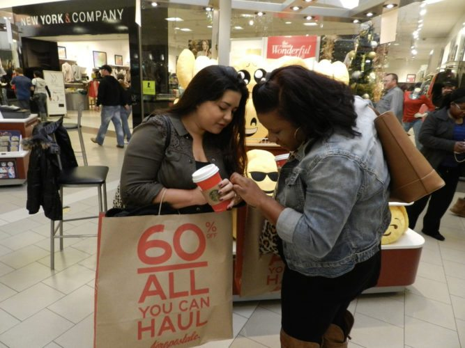 Angelica Echegoyen and Brooke Butler, both of Winchester, make Black Friday into a day to catch up over coffee and shopping at the Apple Blossom Mall in Winchester.  Rachel Mahoney/Daily